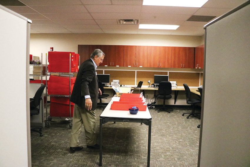 Merlin Klotz, the county's clerk and recorder and the designated election official, looks at sorting boxes in the election headquarters. This is the room where ballot signatures are manually verified.
