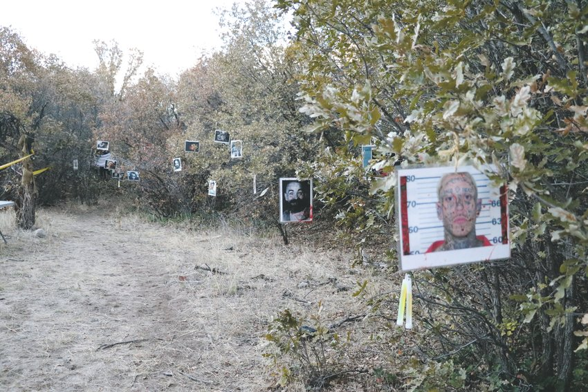 Photos of known killers hung from trees along a portion of the Haunted Forest in the Highlands Ranch Backcountry during the Oct. 18 through 19 event.