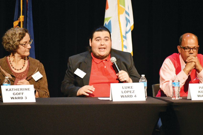Ward 4 Northglenn Council candidate Luke Lopez makes a point while opponent Paul Kelly, right, and Ward 3 candidate Katherine Goff, listen during a candidate forum Oct. 16.