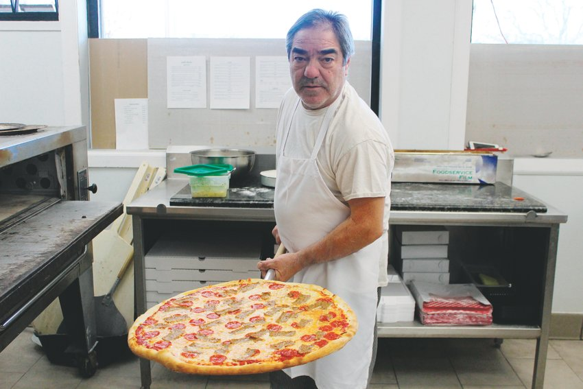 Vincenzo Pollio, a chef at Gallo Italian Supper Club and Bake, shows off a pizza. Every dish at the restaurant is made from scratch.