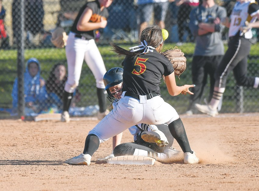 Arapahoe's Leah Cackowski (7) makes the successful slide to second base, just beating the ball to Rocky Mountain's Cora Aguirres (5). The Warriors had a 12-run sixth inning to beat Smoky Hill 12-1 in earlier rounds before falling to Rocky Mountain 11-1 in the quarterfinal Oct. 25 at Aurora Sports Park.