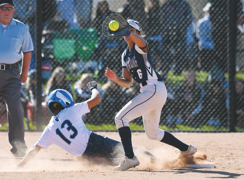 Valor Christian's Nico Ortiz (13) makes the successful slide to second base, beating the throw during the opening round of the state softball finals. The Eagles fell 10-0 to eventual state champion Columbine on Oct. 25.
