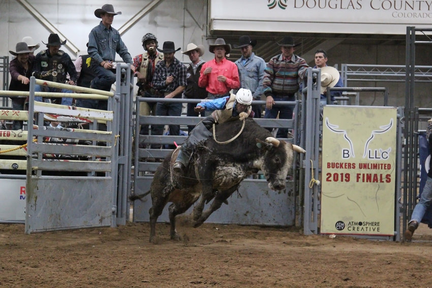 A bull and rider burst into the arena after the gate is opened during and Oct. 26 competition in Castle Rock.
