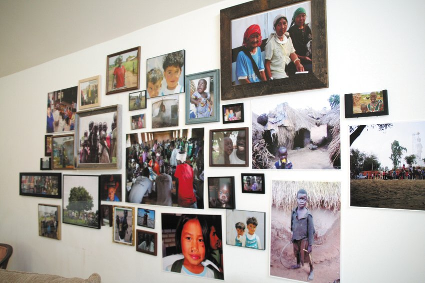 Photos in the upstairs seating area of the coffee shop put faces on the work that Global Refuge International does in Uganda, Syria, Lebanon and many other countries.
