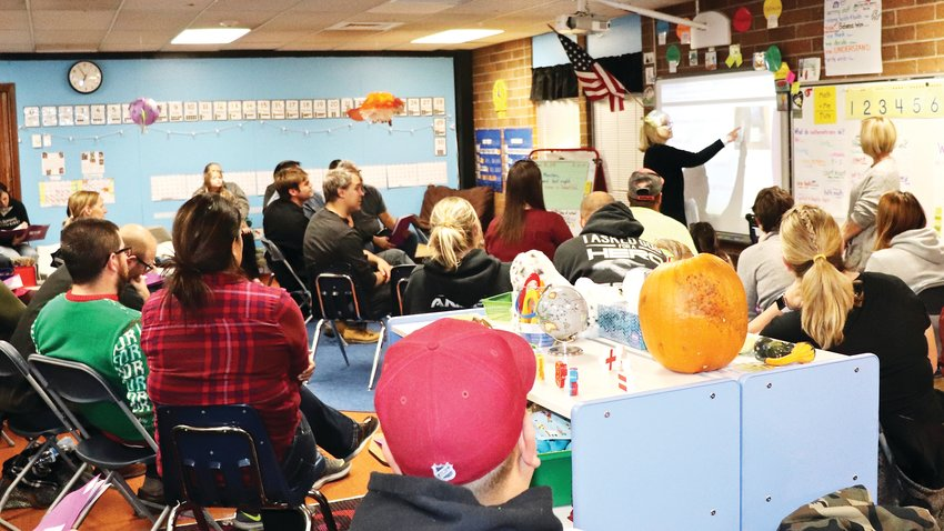 Parents go back to the classroom to learn from their students' teachers about how kindergarteners at Little are taught to read, and how parents can help at home.