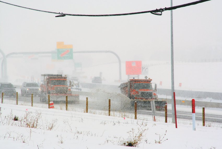 Two plows make their way on C-470 in Highlands Ranch at about 1 p.m. during the Oct. 29 snowstorm. A new law now makes it illegal to pass working snowplows.