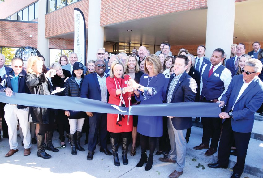 Members of the South Metro Denver Realtor Association, along with officials and leaders from Centennial, participate in a ribbon-cutting ceremony on Oct. 11 to celebrate the association's new headquarters at 6436 South Racine Circle.
