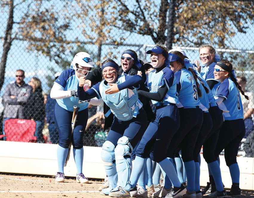 Riverdale Ridge softballers celebrate a home run by teammate Sienna Mullin, in the Ravens' CHSAA 3A state playoff win over The Academy of Broomfield, Oct. 25, at Aurora Sports Park. The 7-2 victory, their first ever at the state championship level, would be short-lived, as they lost in the next round to Strasburg, 6-5.
