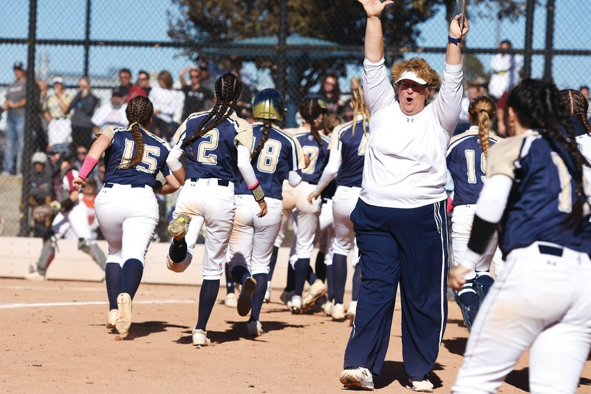 Legacy Head Coach Dawn Griffin celebrates her team's 3-2, extra-inning victory over Chatfield, in the Lightning's first CHSAA 5A state playoff game at Aurora Sports Park, Oct. 25.