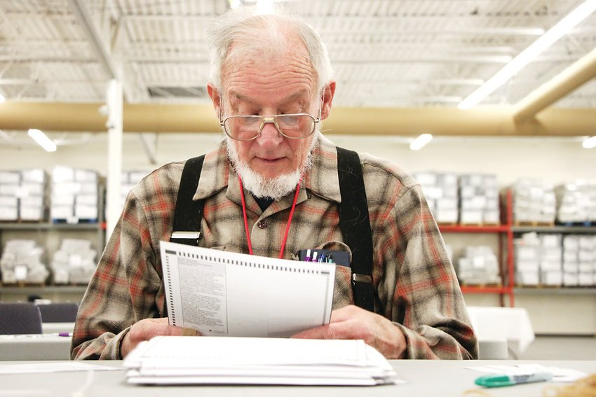 Doug Cohn, a temporary employee, opens ballots at Arapahoe County's election facility on Oct. 26.