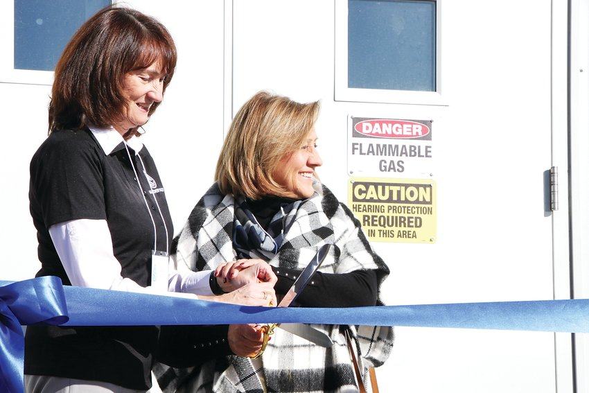 Englewood Mayor Linda Olson, left, and Littleton Mayor Debbie Brinkman cut the ribbon on the biogas facility at South Platte Water Renewal Partners, the southwest metro area's wastewater treatment plant. The system will capture waste gases to sell as fuel to Xcel Energy.