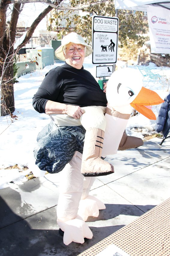 Dianna Hutton dressed as an explorer riding an ostrich for Halloween as she worked a booth at the Castle Rock festival in Festival Park.