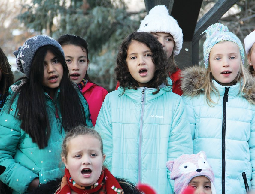 Children sing holiday-themed songs Nov. 1 at the first Holiday Art Market at Big Tool Box and Highlands Garden Center in southwest Centennial.