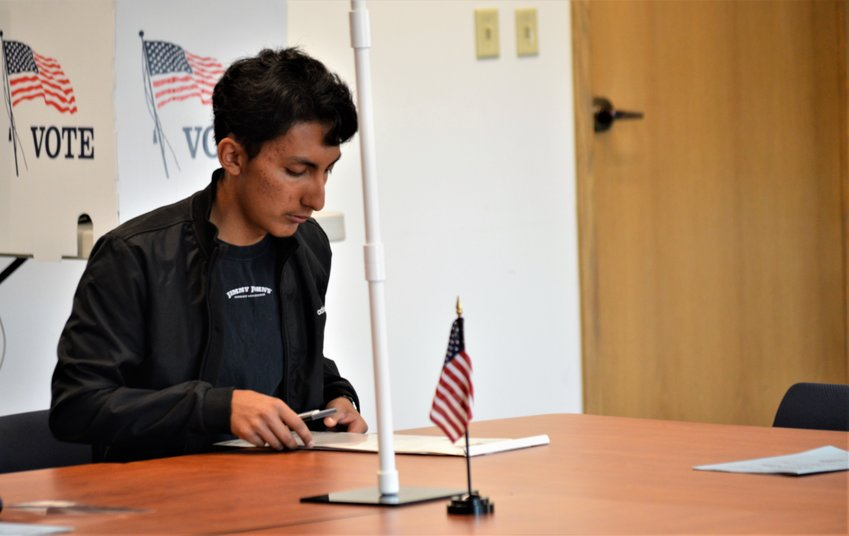 Gabriel Cervants of Thornton fills out his ballot paperwork Nov. 5 at Adams County's 122nd and Pecos voter service center. His brother Steven Cervantes was on the ballot, seeking the Thornton mayor's job.