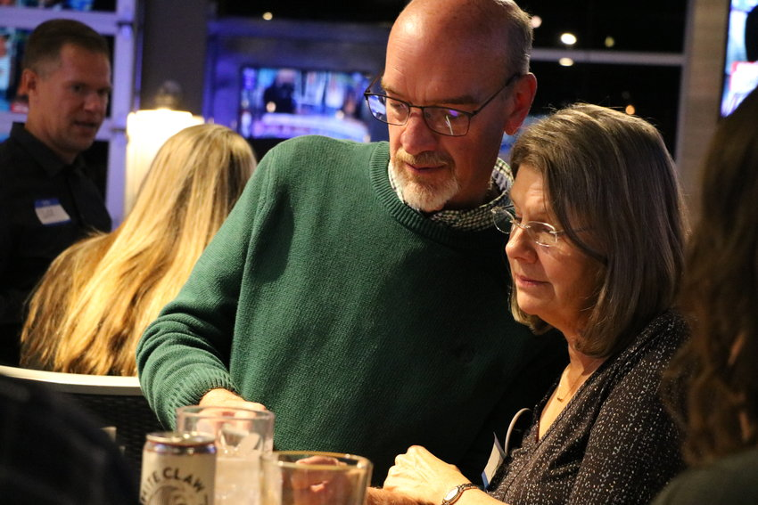 School board president and incumbent David Ray and his wife look at the latest round of election results Tuesday, Nov. 5.