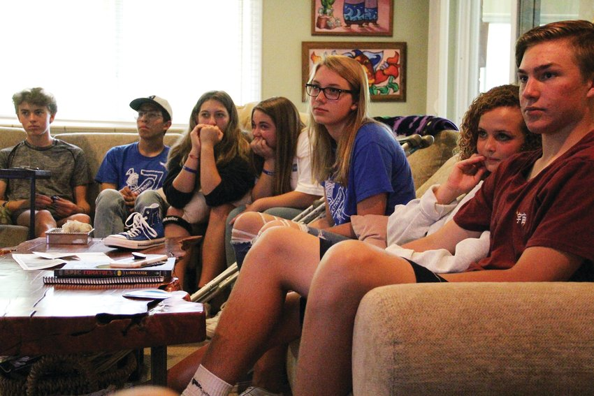 "From left, Karsen Kramer, Gio Villagrana, Tessa Boettcher, Olivia Heichel, Lily Osborne, Brook Bennett and Sailor Ross, who meet under the name ""#jackstrong,"" sit Sept. 8 at the home of Jack Padilla's father. They watched rough footage of what would become PSA-style videos about teen suicide, released Oct. 8, that students in the group contributed to."
