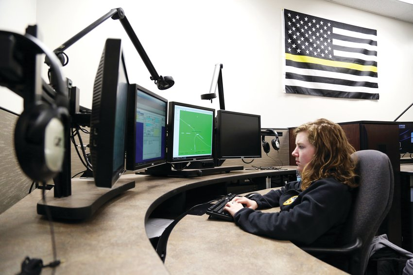 Student Ashlynn Koger, 17, transcribes a 911 call in the emergency dispatcher class at Warren Tech earlier this year.