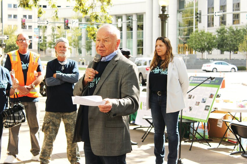 David Henninger, the co-founder and executive director of Bayaud Enterprises, speaks at an event launching the nonprofit's new shower truck. The truck features two accessible showers, which will have toiletries for homeless individuals.
