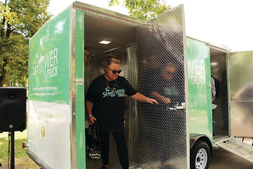 Vikki Stevens steps out of the new shower truck after taking a look inside. Bayaud Enterprises, a nonprofit which works to provide employment and other resources to the homeless, launched the truck last month.