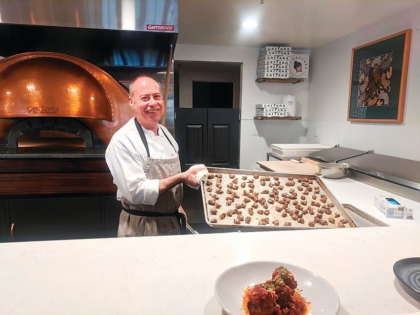 Gian Frau, a chef at the new Gattara restaurant, takes sausage out of the oven. The new restaurant is located inside the Warwick Denver Hotel.