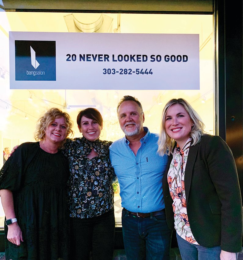 Bang Salon owners Rodger and Lisa Garcia, center, celebrate 20 years of business in Washington Park with Park Hill owner, Sandy Dreckman, left, and Stacy Kelley.