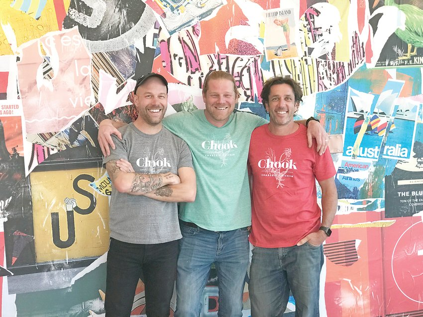 Alex Seidel, center, stands inside Chook with his fellow co-founders of the restaurant. Chook is a charcoal roasted chicken restaurant on South Pearl Street.