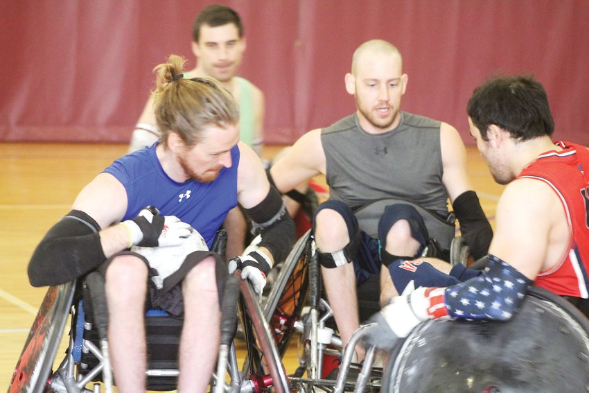 Jake Daily, left, Josh O'Neill and Chuck Aoki battle it out during a practice for the Denver Harlequins wheelchair rugby team on Nov. 7 at the Charles Whitlock Recreation Center in Lakewood. The team has won the Tampa International Wheelchair Rugby Tournament two years in a row.