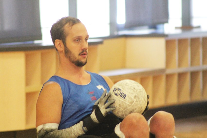 Eric Newby surveys for a teammate to pass the ball to. Newby has been part of the USA Wheelchair Rugby team since 2012 and joined the Denver Harlequins in 2016.