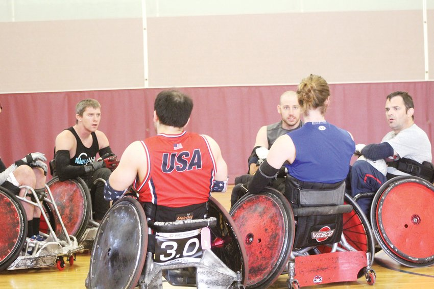 Coach of the Denver Harlequins, Jason Regier, far right, addresses his team. Regier will coach the Denmark Wheelchair Rugby team in the 2020 Summer Paralympics in Tokyo.