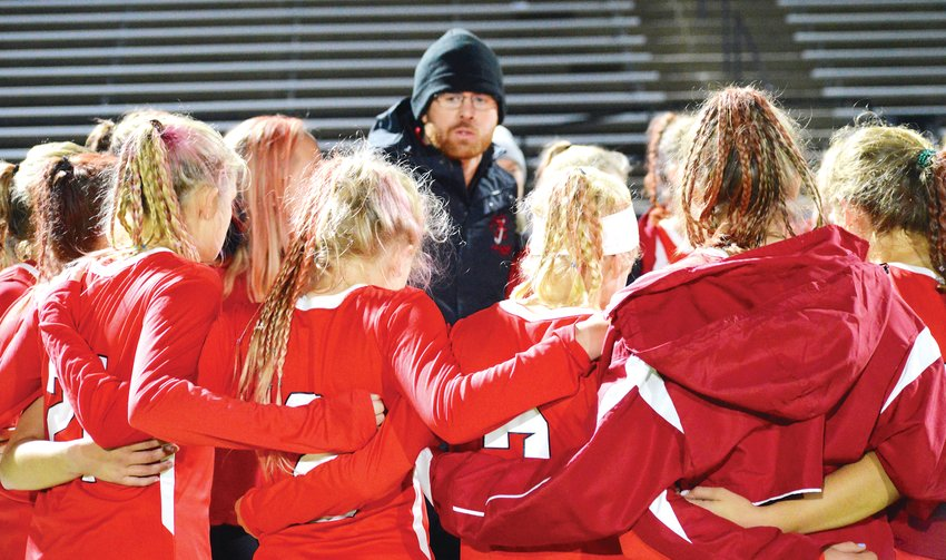 Regis Jesuit coach Spencer Wagner talks to his team after a 2-1 loss to Colorado Academy on Nov. 5 in the state championship field hockey game held at All-City Stadium.