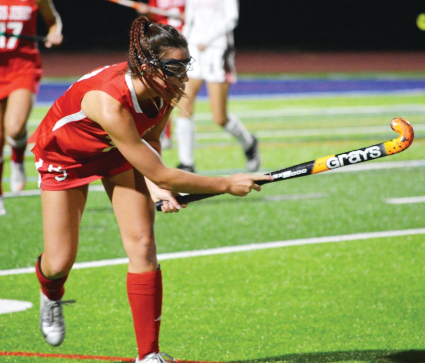 Cate Lord (12) of Regis Jesuit hits the ball up field during the Nov. 5 state championship field hockey game played at All-City Stadium. Colorado Academy won 2-1.