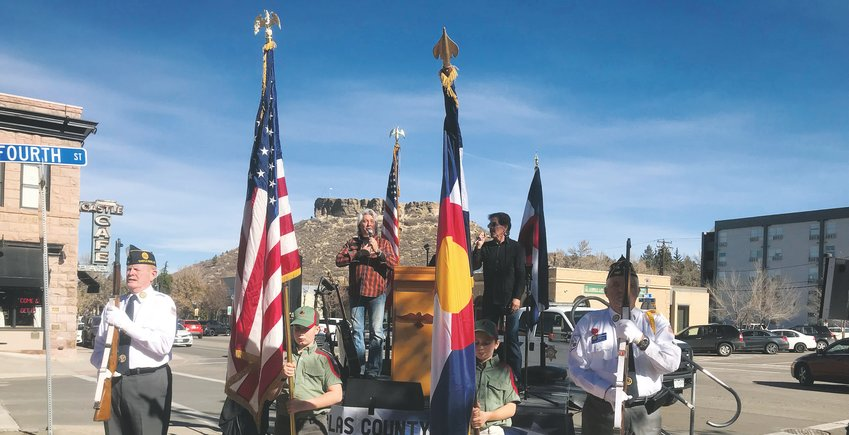 A color guard made up of Trail Life scouts and members from the American Legion Post 1187 (Castle Rock) present the American and Colorado flags at the corner of Fourth and Wilcox streets Nov. 9.