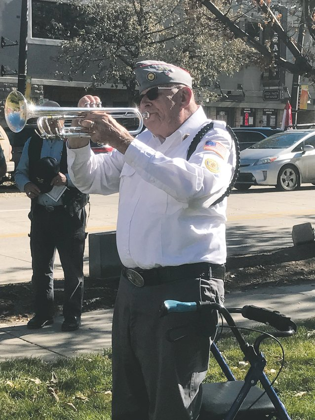 A veteran plays taps during the Douglas County Veterans Day Tribute in downtown Castle Rock Nov. 9.