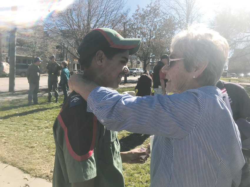 Caleb Sathianathan is embraced by a patron of the Veterans Day Tribute in downtown Castle Rock Nov. 9. Satianathan recited a poem honoring veterans to close the ceremony.