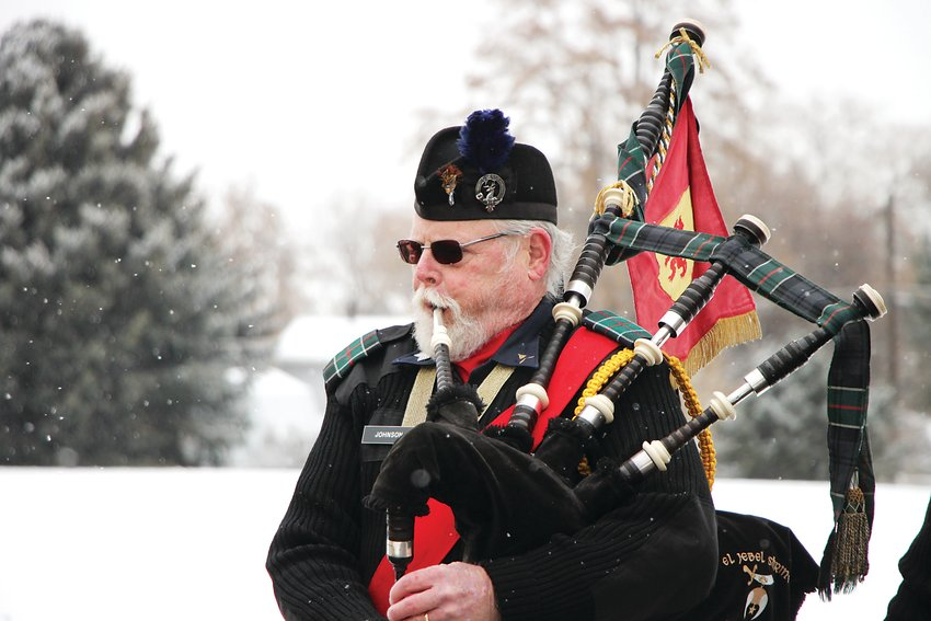 Tom Johnson, a pipe major with the El Jebel Shrine's bagpipe band, plays Amazing Grace.