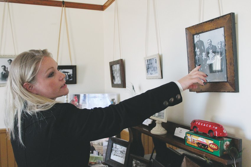 Elizabeth Matthews, Executive Director of the Schweiger Ranch Foundation, gives a tour of the Schweiger Ranch property, pointing to a photo of the original Schweiger family who homesteaded there in the 1800s.
