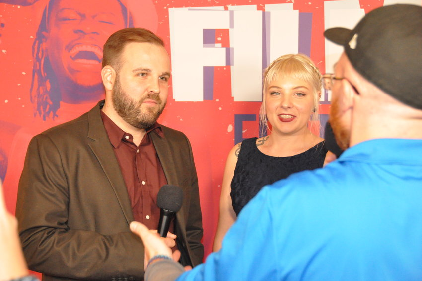 Filmmakers at the 42nd annual Denver Film Festival's red carpet opening night get interviewed by media.
