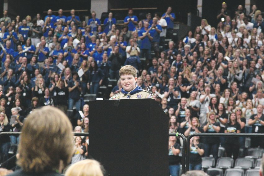 Rocky Heights Middle School student Kendall Meibos speaks to thousands of Douglas County School District employees at the Pepsi Center.