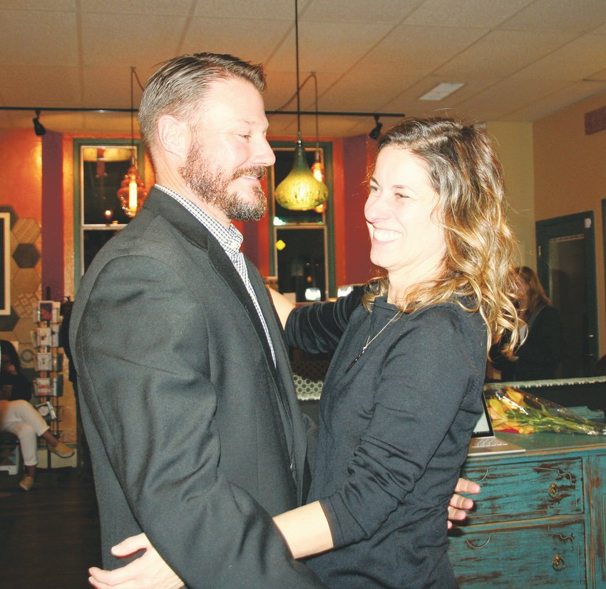 Laura Weinberg goes in for a hug from her husband Mike during her watch party on Nov. 5 at Cafe 13 in downtown Golden.