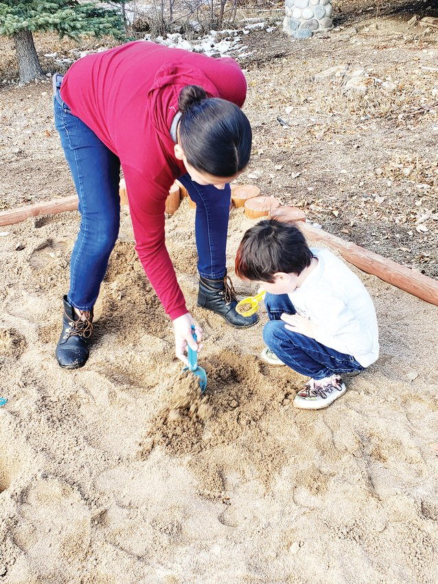 Cousins Ashlynn Bracher and Rafael Dunlap dig in the City of Westminster's Paleo Dig Site, at the Standley Lake Regional Park. Park Rangers will host a special event to discuss the city's dino-filled history Nov. 16 at the Paleo Dig site.