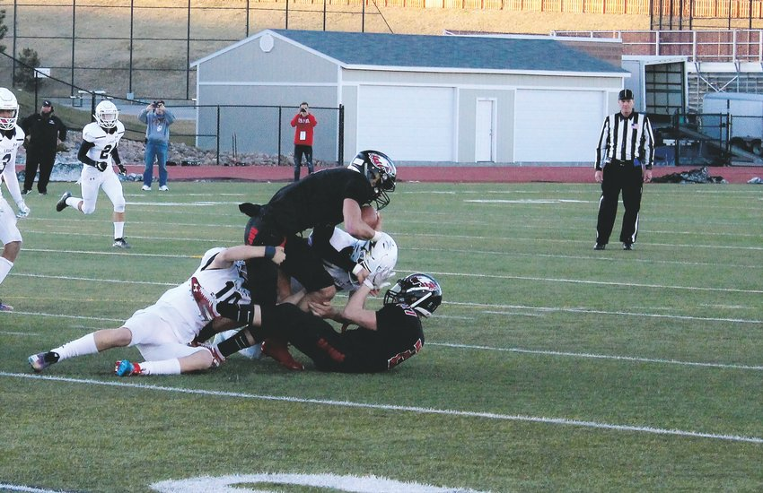 Nov. 8 at Legacy Stadium, Legacy sophomore Michael McCarty makes the tackle against Eaglecrest.