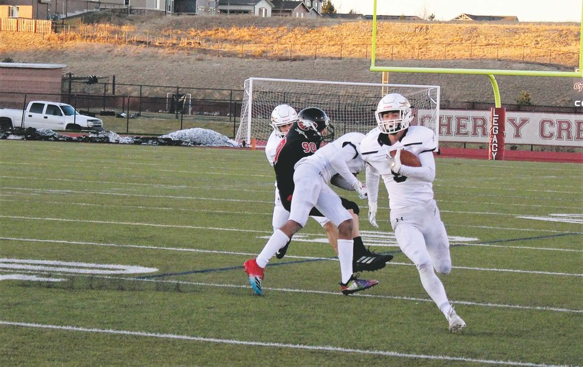 Legacy sophomore Blake Roberts returns the punt against Eaglecrest in the opening round of the 5A state playoffs Nov. 8 at Legacy Stadium.