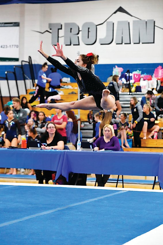 Julia Folmar performs the floor routine at the 4A State Championships for gymnastics.