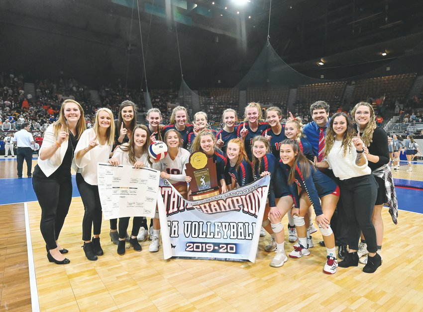 Chaparral celebrates its Class 5A championship after defeating Valor Christian 3-1 on Nov. 16 at the Denver Coliseum.