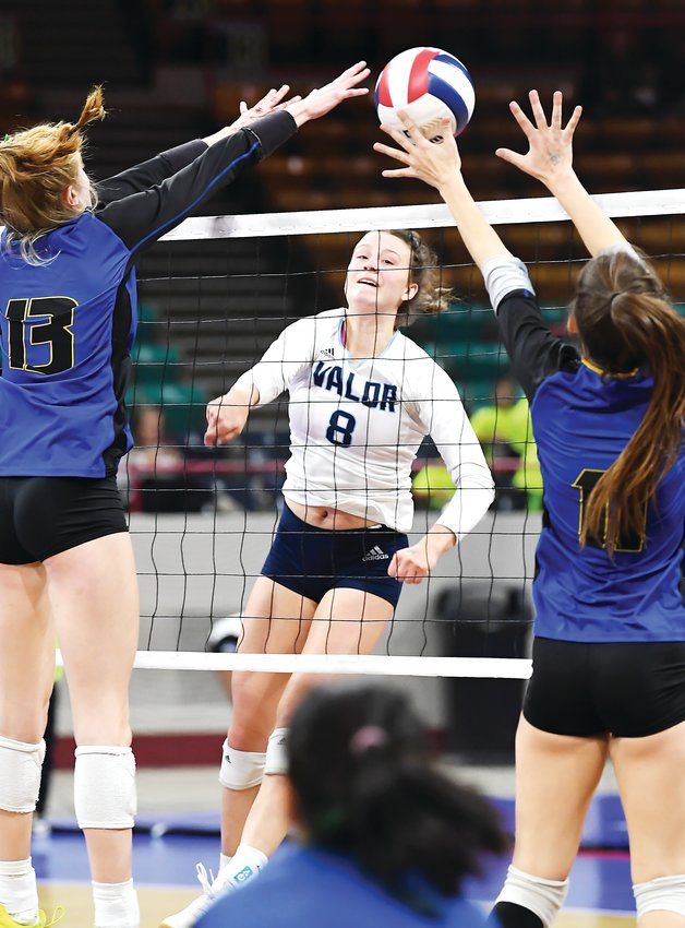 Valor Christian's Anna Davis's kill shot finds the gap between two Rampart defenders. Valor defeated several early round contenders but fell to Chaparral 3-1 in the state final Saturday at the Denver Coliseum.