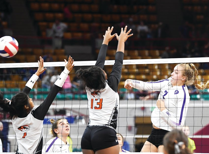 Lutheran's Payton Brgoch (2) lines up her K attempt just past the reach of Sterling defenders Emerie Rios (1) and Kaylee Johnson (13). The Lions defeated several early round contenders but fell to Sterling in the state final Saturday at the Denver Coliseum.