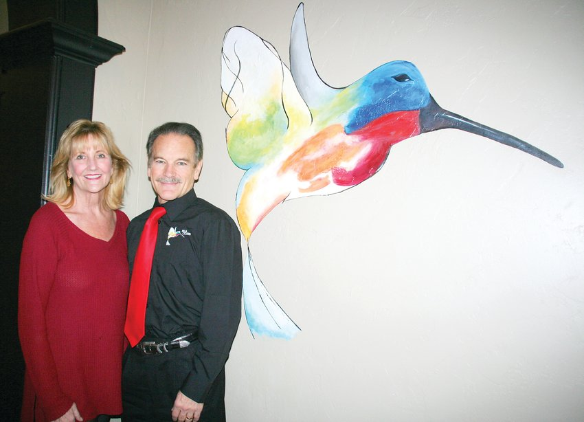 Aimee and Dean Valdez stand in the entryway of their new restaurant, Bella Colibri. The name in Italian means beautiful hummingbird. The hummingbird in the entryway was painted by Golden artist Alyssa Graves.