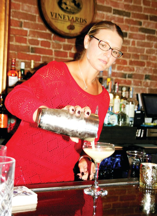 Tiffany Nelson, Bella Colibri's manager, pours an Italian sour, which is a frothy whiskey drink, on Nov. 13. Bella Colibri, 812 12th St., is Golden's new upscale Italian dining experience.