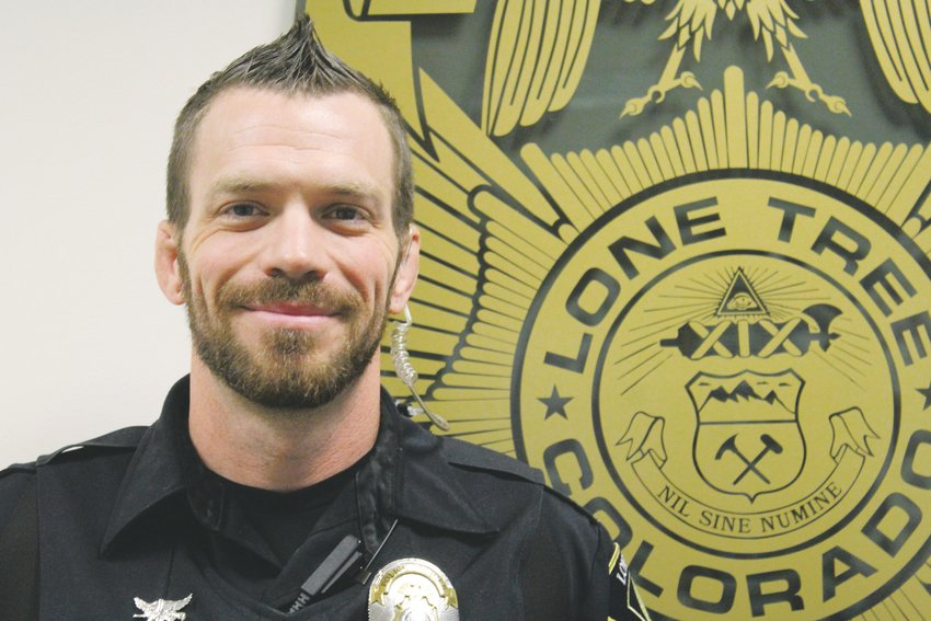 Officer Reid Perry is one of the officers participating in Movember to raise money for research of men's health issues.