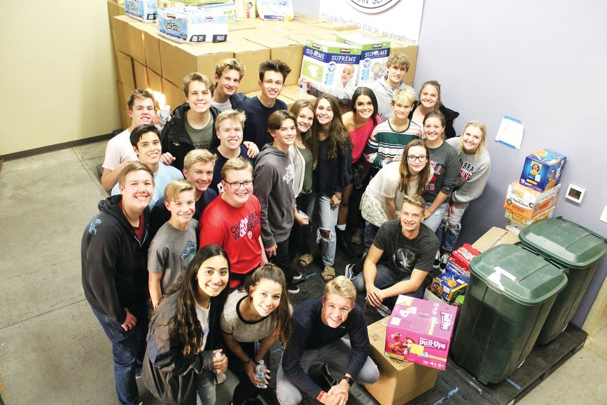 A group photo of the Chaparral student government who helped move boxes donated by Chaparral students Nov. 13. In the photo: Shima Soleimanpour, Tatiana Duran, Josh Covak, Andi Thompson, Hannah Worland, Megan Arnett, Carly Lehman, Caleb Covak, Brayden Bacon, Morgan Huppert, Grace Mooney, Carley Cantalamessa, Joel Organ, Campbell Cantalamessa, Brooks Bacon, Cayden Cooper, Patrick Hogan, Ben Morris, Tanner Westenskow, Ben Thompson, Jarek Miller, Tanner Anderson, Lance Kirkpatrick.